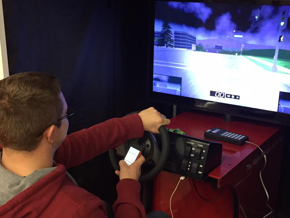 A student testing out the text and drive simulator.